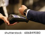 man paying with nfc technology... | Shutterstock . vector #686849080