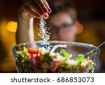 woman preparing healthy salad... | Shutterstock . vector #686853073