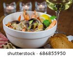 seafood stew with clams and... | Shutterstock . vector #686855950