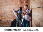 happy couple making repairs to...   Shutterstock . vector #686862826