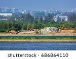 land reclamation backhoes carry ... | Shutterstock . vector #686864110