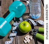 fitness concept   dumbbell ...   Shutterstock . vector #686868784