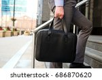 businessman walking and holding ... | Shutterstock . vector #686870620