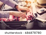 travelers are packing their... | Shutterstock . vector #686878780