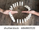 hand stopping domino effect of...   Shutterstock . vector #686883520