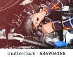 close up hands checking lube... | Shutterstock . vector #686906188