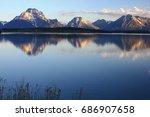 reflection of the teton...   Shutterstock . vector #686907658