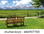 wooden chairs facing the teton...   Shutterstock . vector #686907700