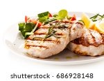 grilled steaks and vegetables | Shutterstock . vector #686928148