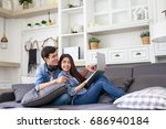 young asian couple relaxing... | Shutterstock . vector #686940184
