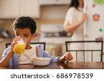 little boy drinking orange... | Shutterstock . vector #686978539