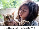 Stock photo cute cat and girl love 686989744