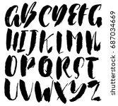 hand drawn dry brush font.... | Shutterstock .eps vector #687034669