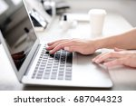 hands of a woman working at a... | Shutterstock . vector #687044323