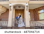 groom with the bride near the... | Shutterstock . vector #687046714