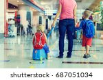 mother and two kids walking in... | Shutterstock . vector #687051034