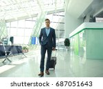 business man with suitcase in... | Shutterstock . vector #687051643