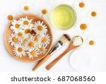 chamomile flowers and extracted ... | Shutterstock . vector #687068560