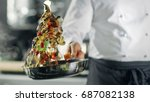 professional chef cooks flambe... | Shutterstock . vector #687082138