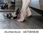 young woman suffering from legs ... | Shutterstock . vector #687084838