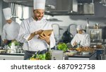 famous chef uses tablet...   Shutterstock . vector #687092758