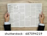 Businessman Reading Newspapers...
