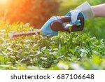 hands with garden battery... | Shutterstock . vector #687106648