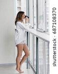 beautiful young woman drinking... | Shutterstock . vector #687108370