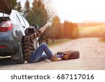 the man is sitting on the road... | Shutterstock . vector #687117016