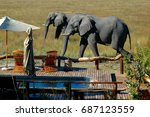 elephants by the swimming pool. ... | Shutterstock . vector #687123559