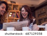 two girls sitting in a cafe ...   Shutterstock . vector #687129358