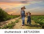 cowboy siblings walking in the... | Shutterstock . vector #687142084
