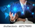 Small photo of Double exposure of businessman hand hold light blue polygon brain and line node networking world map as business, globalization, technology, communication, innovation and knowledge concept