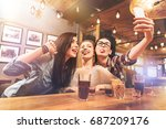 Stock photo playful females showing their tongues 687209176