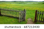 An Open Gate In A Wooden Fence...