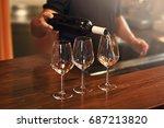 sommelier fills the glasses... | Shutterstock . vector #687213820