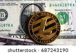 litecoin on one dollar banknote | Shutterstock . vector #687243190