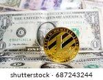 litecoin on one dollar banknote | Shutterstock . vector #687243244