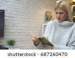 caucasian woman reading. young...   Shutterstock . vector #687260470