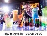 the barman finishes preparing...   Shutterstock . vector #687260680