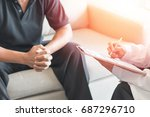 doctor physician consulting... | Shutterstock . vector #687296710