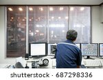 Engineer in control room.
