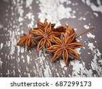 spices. anise stars on the... | Shutterstock . vector #687299173