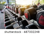 rows of dumbbells in the gym... | Shutterstock . vector #687332248