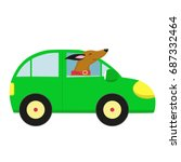 A Smiling Dog In A Green Car