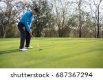 man playing golf on a golf... | Shutterstock . vector #687367294