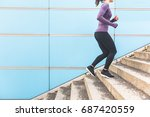 woman jogging and running up a... | Shutterstock . vector #687420559