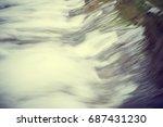 water flowing over a weir ... | Shutterstock . vector #687431230
