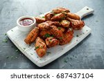 baked chicken wings with sesame ... | Shutterstock . vector #687437104