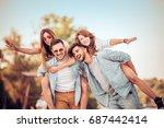 happy young friends having fun... | Shutterstock . vector #687442414